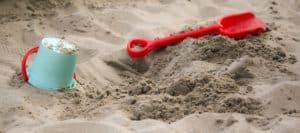 baby play in a sandbox